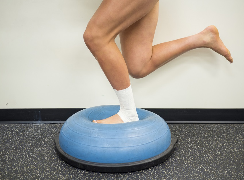 Athlete with a sprained ankle doing strengthening and balance exercises